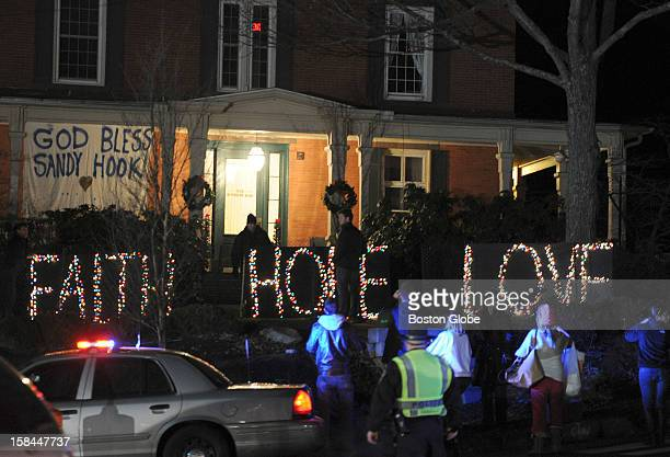 """Sign that reads, """"Faith, Hope, Love,"""" was lit up in downtown Newtown, Conn. On Dec. 15 one day after a gunman walked into Sandy Hook Elementary..."""
