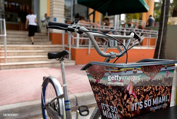 A sign that reads 'It's So Miami' is displayed on a rental bicycle in front of Starbucks Corp coffee shop in the South Beach neighborhood of Miami...
