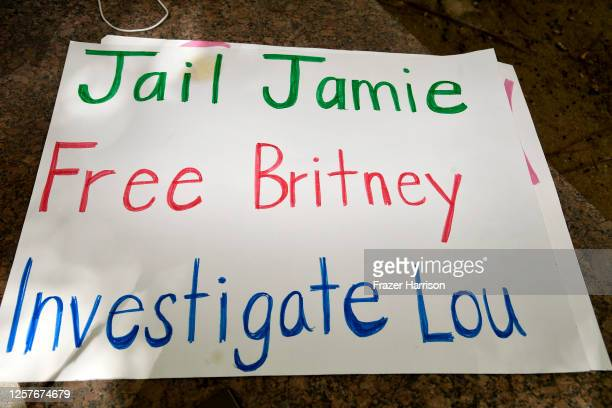 A sign that reads Jail Jamie Free Britney Investigate Lou sits on the ground as supporters of Britney Spears gather outside a courthouse in downtown...
