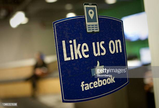 A sign that reads 'Like us on Facebook' is displayed in the entry way at Facebook Inc's office in New York US on Tuesday Dec 20 2011 'Cool spaces'...