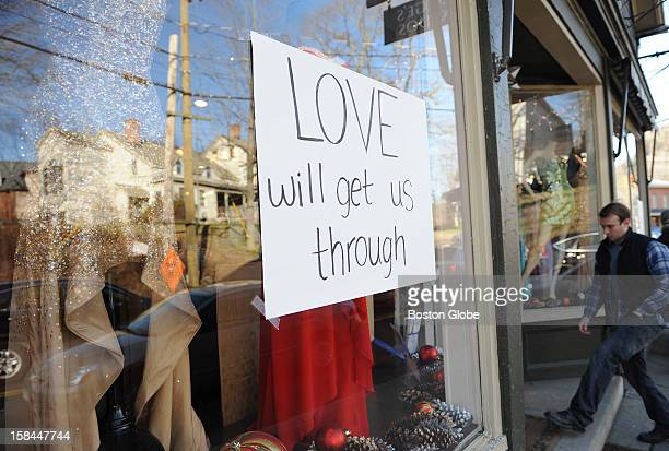 """Sign that reads, """"LOVE will get us through,"""" was posted in a storefront window in downtown Newtown, Conn., on Dec. 15 one day after a gunman walked..."""