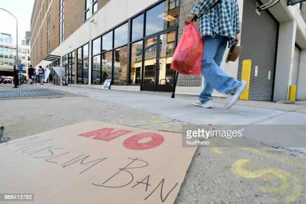 Sign that reads No Muslim Ban is left after a group of protestors rallied at a local Dept of Homeland Security Immigration Field Office in...