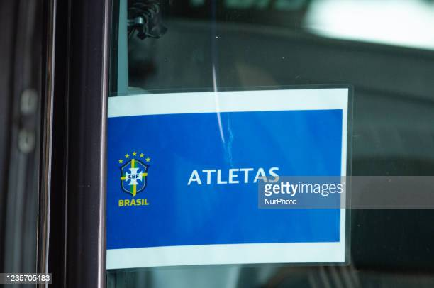 """Sign that reads """"Athletes"""" with the Brazil team logo is seen in a bus as members of the Brazil federation of football team board their bus..."""