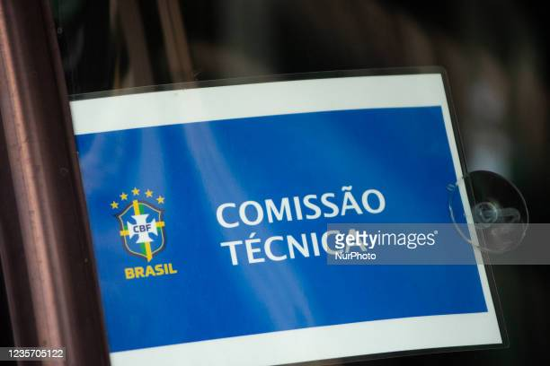 """Sign that reads """"technical committee"""" in a bus as members of the Brazil federation of football team board their bus at the Grand Hyatt..."""