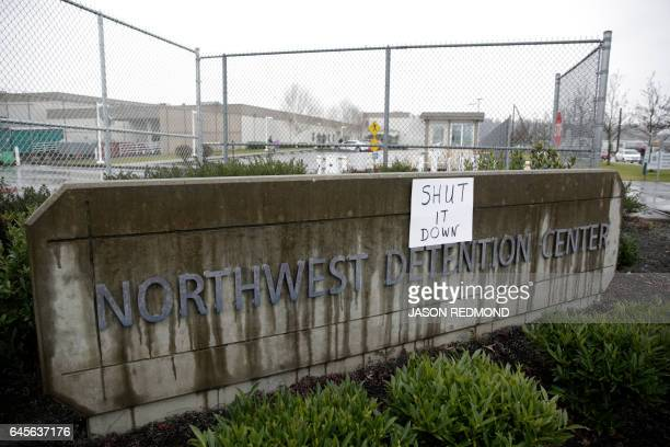 A sign that reads shut it down is pictured at the Northwest Detention Center as people attend the Peoples Tribunal Against the Detention Center event...