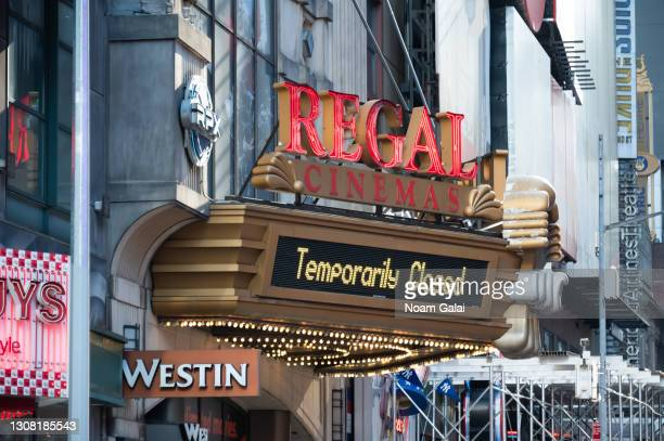 Sign that reads, 'temporarily closed' is seen outside Regal Cinemas in Times Square amid the coronavirus pandemic on March 20, 2021 in New York City....