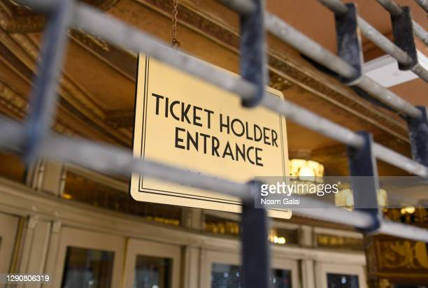 """Sign that reads, """"ticket holder entrance"""" is seen behind a fence outside the Beacon Theatre on the Upper West Side as the city continues the..."""
