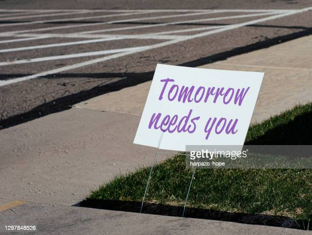 """sign that reads """"tomorrow needs you"""" placed by a sidewalk. - suicide stock pictures, royalty-free photos & images"""