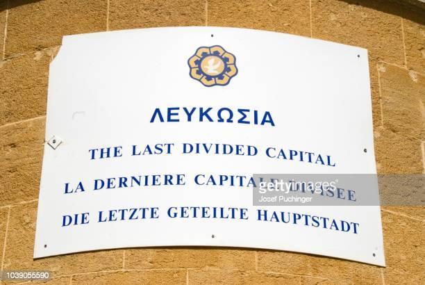 sign, the last divided capital, nicosia, cyprus, greek part, member of the eu - kapitell stock-fotos und bilder