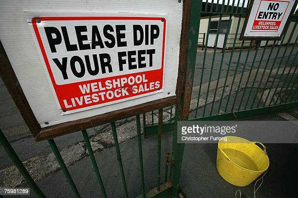 Sign urges visitors to use a footbath - which has been in use since the first outbreak of Foot and Mouth in 2001 - at the entrance to Welshpool...