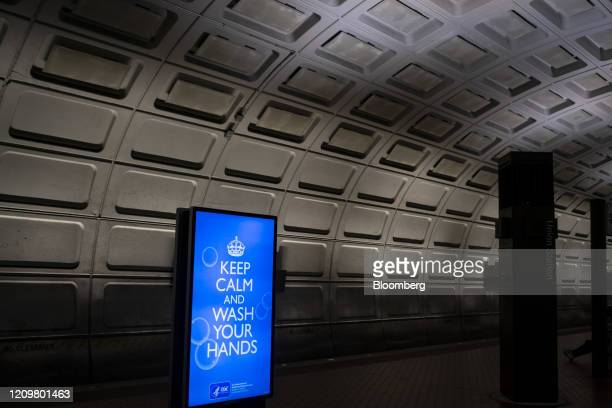 Sign urging commuters to wash their hands is displayed at the Union Station subway stop in Washington, D.C., U.S., on Monday, April 13, 2020....