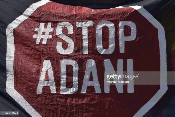 A sign used by protesters gathered in front of Parliament House to campaign against the construction of the Adani coal mine on February 5 2018 in...