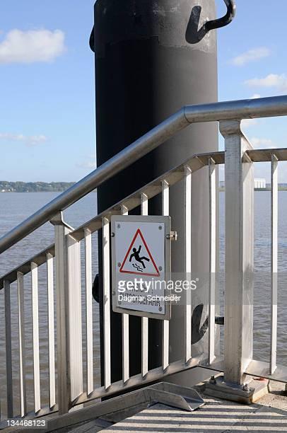 A sign Vorsicht Rutschgefahr, German for caution, slip hazard at the Hamburg harbour, Germany, Europe