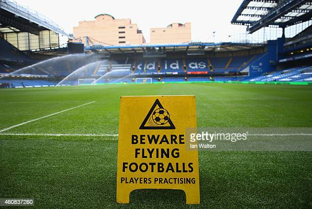 A sign warning about flying footballs is seen pitchside prior to the Barclays Premier League match between Chelsea and West Ham United at Stamford...