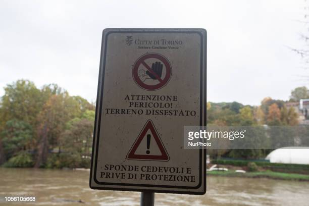 A sign warning because of the terrain next to the Po Impressions of the Fall in the capital of Piedmont Turin in Northern Italy on 1st November 2018