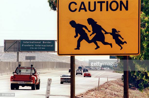 A sign warning drivers about pedestrians running across the highway is posted by the side of the highway at the USMexican border near San Diego 19...