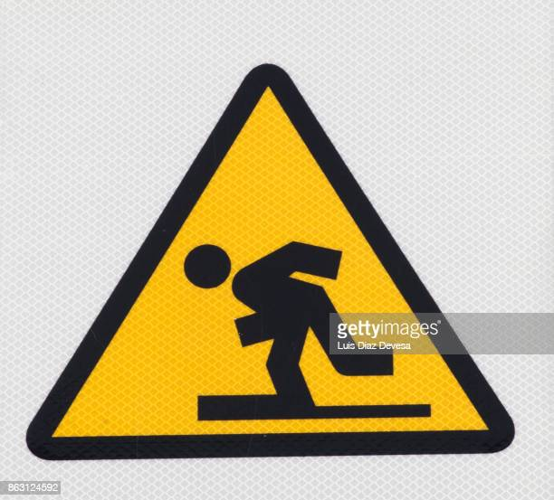sign warning for risk of falling - steep stock pictures, royalty-free photos & images