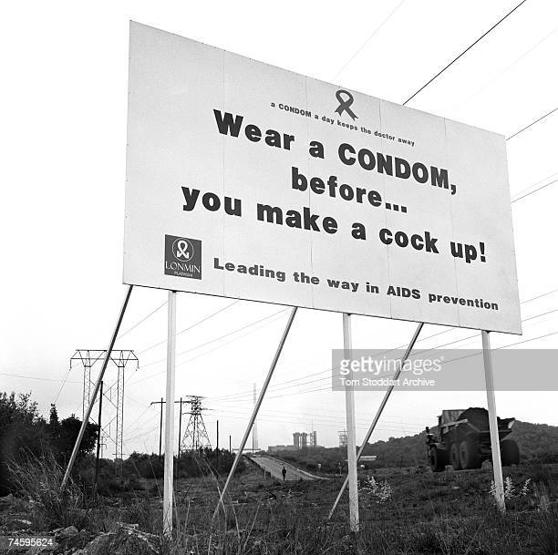 A sign warning miners about the dangers of HIV/AIDS at the Lonmin platinum mine in the Marikana area of South Africa October 2000 17000 men work in...