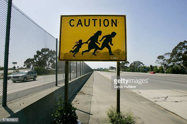 A sign warning motorists to beware of people crossing the road is seen on Interstate 5 just North of the USMexico border May 13 in San Ysidro...