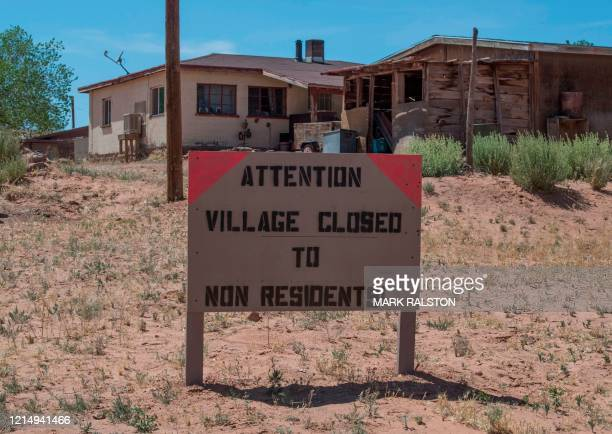 Sign warning non residents to stay out in the Navajo Nation town of Tuba City during the 57 hour curfew, imposed to try to stop the spread of the...