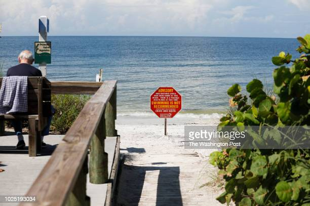 August 26: A sign warning of a no swim advisory warns visitors at Lido Beach on August 26, 2018 in Sarasota, Florida. Florida Governor Rick Scott...