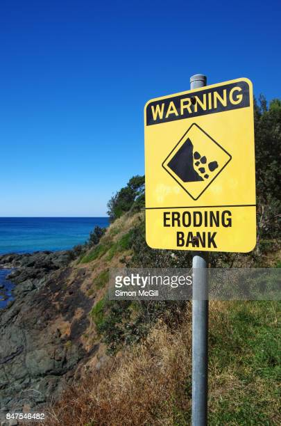 Sign warning of an eroding bank at Nobby's Head, Port Macquarie,  New South Wales, Australia