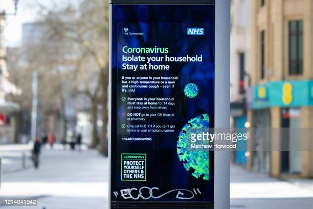 Sign warning of coronavirus on Queen Street on March 22, 2020 in Cardiff, United Kingdom. On Friday UK Prime Minister Boris Johnson announced that...