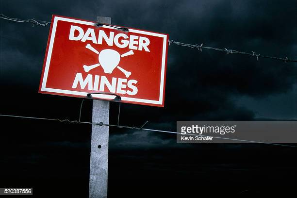 sign warning of mines in falkland islands - falklands war stock pictures, royalty-free photos & images
