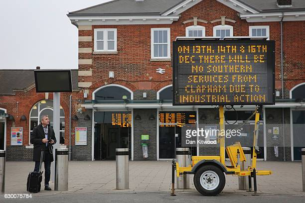 A sign warning passengers of industrial action stands outside Clapham Junction Station on December 16 2016 in London England Commuters across the...