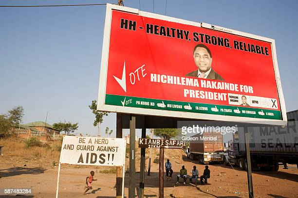 A sign warning people to guard against AIDS is situated close to the border post in Chirundu The large billboard above the sign is advocating one of...