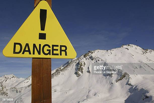 A sign warns about the risks of avalanche February 13 2004 in the French ski resort of Val d'Isere