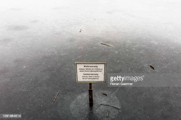 A sign warns against walking on the frozen lake Schlachtensee on February 01 2019 in Berlin Germany