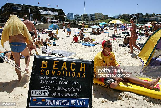 A sign warns bathers of the extreme weather conditions on iconic Bondi Beach as a heatwave and searing winds set a new temperature record for New...