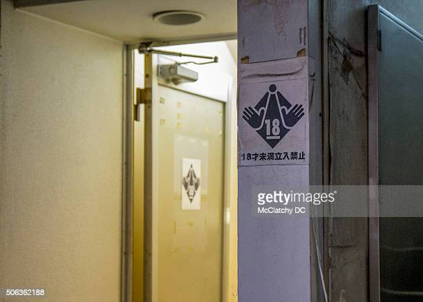 A sign warns clients that they must be 18 years of age to enter the adultthemed business in the red light district of Ikebukuro Tokyo on Dec 12 2015