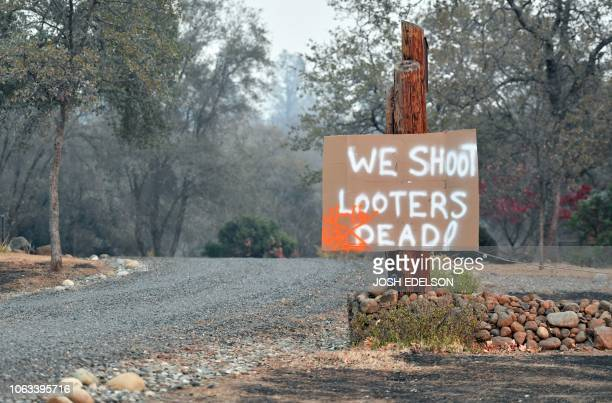 A sign warns looters in Paradise California on November 18 2018