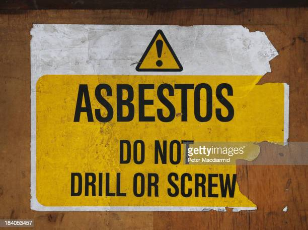 A sign warns of asbestos danger at a former Royal Mail sorting office on October 11 2013 in London England