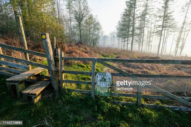 A sign warns of fire risk as firefighters from Cleveland Fire Brigade tackle a woodland fire in the hills above Guisborough on April 21 2019 in...
