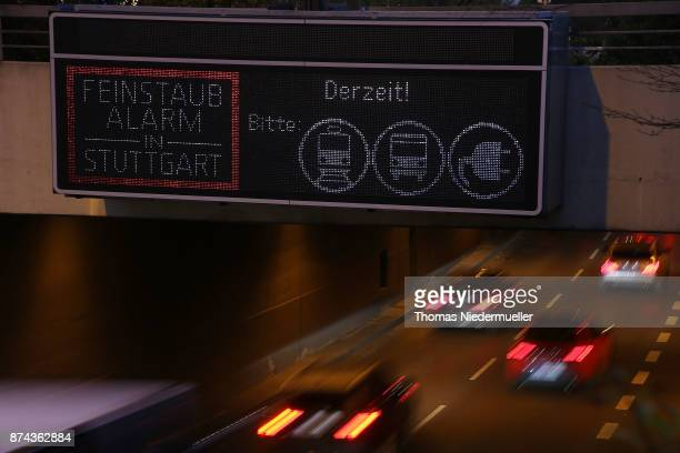 A sign warns of high levels of particulates a form of pollutants on the day the city announced a pollution alarm on November 15 2017 in Stuttgart...