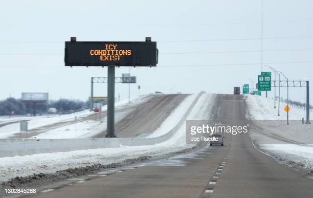 Sign warns of icy conditions on Interstate Highway 35 on February 18, 2021 in Killeen, Texas. Winter storm Uri has brought historic cold weather and...