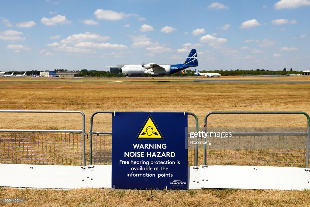 A sign warns of noise hazard as a LM-100J aircraft, produced