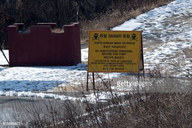 A sign warns of North Korean landmines on a bridge crossing between North and South Korea in the Demilitarized Zone between South and North Korea on...