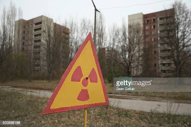 Sign warns of radiation contamination near former apartment buildings on April 9, 2016 in Pripyat, Ukraine. Pripyat, built in the 1970s as a model...