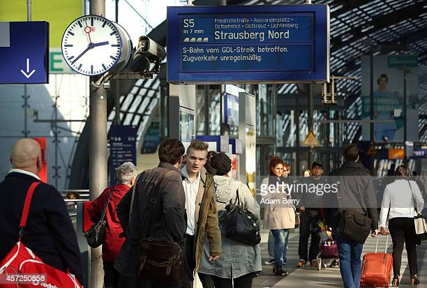 A sign warns passengers of train strikes at the central station in Berlin as train employees strike on October 15 2014 in Berlin Germany Train...