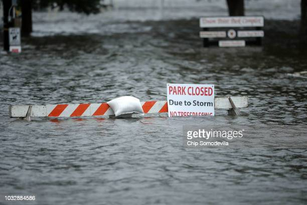 A sign warns people away from Union Point Park after is was flooded by the Neuse River during Hurricane Florence September 13 2018 in New Bern North...