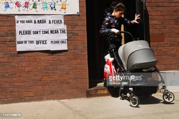 A sign warns people of measles in the ultraOrthodox Jewish community in Williamsburg on April 10 2019 in New York City As a measles epidemic...