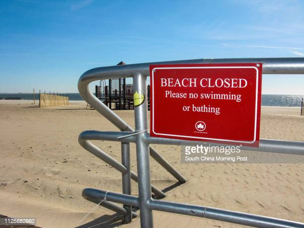 A sign warns people that the beach is closed on Coney Island in New York on 15 November 2013 [05JANUARY2014 TRAVEL POST MAGAZINE]
