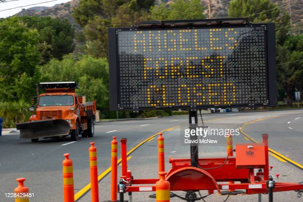 Sign warns residents that the Angeles National Forest as the Bobcat Fire burns nearby on September 9, 2020 near Monrovia, California. The U.S. Forest...