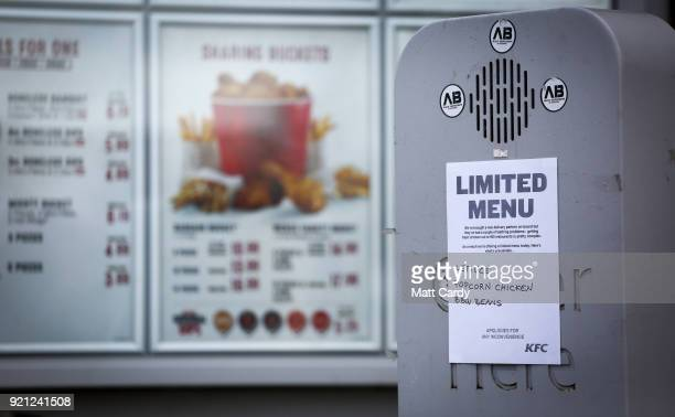 A sign warns that a limited menu is being operated at a branch of KFC that is operating a limited menu due to problems with the delivery of chicken...
