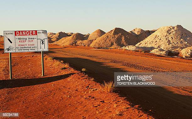 A sign warns tourists of the dangers of explosives and several hundred thousand abandoned mine shafts scattered around the opal mining town of Coober...