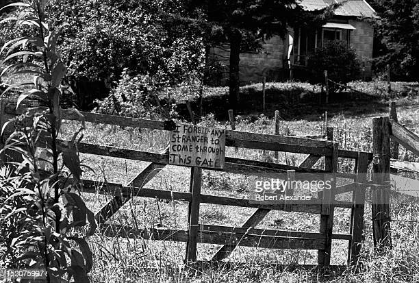 A sign warns trespassers in front of a rural home in southwest Virginia near Damascus Va The sign was posted by the landowner in response to the US...